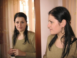 4754-a-young-woman-looking-at-herself-in-the-mirror-pv